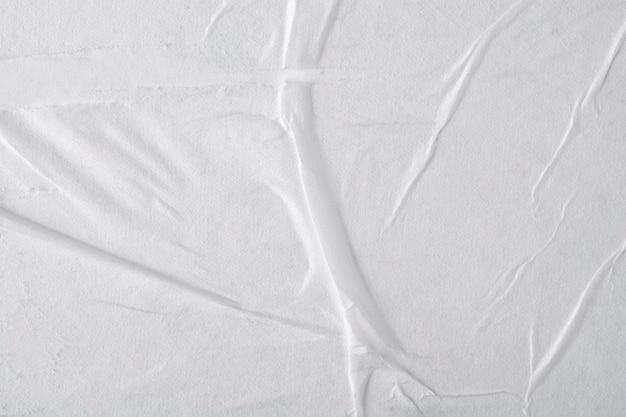 Белая бумага со складками.
