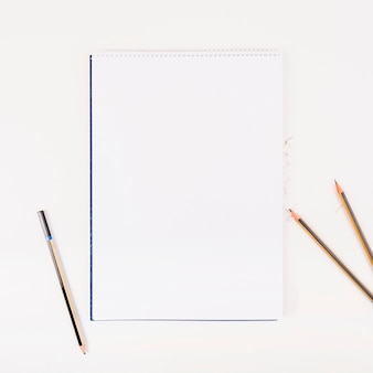 White paper with pencils