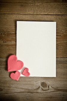 White paper with small pink hearts
