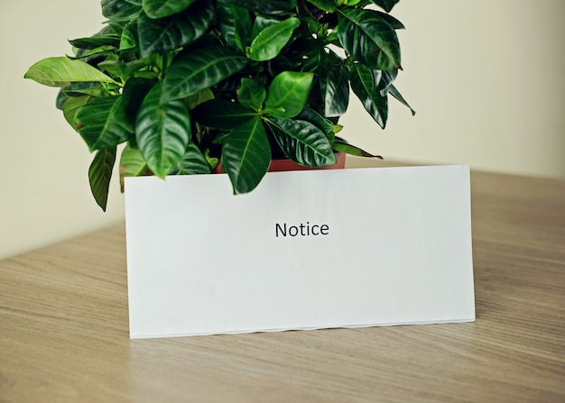 White paper with text notice in the office
