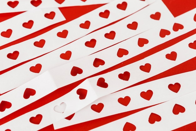 White papers with cut hearts