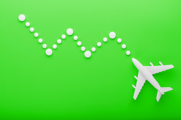 White passenger plane with trajectory points as on a route map