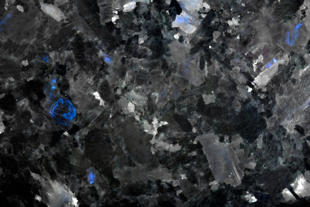 White pattern natural detailed of black marble texture and background for product and interior design. black granite with blue crystals