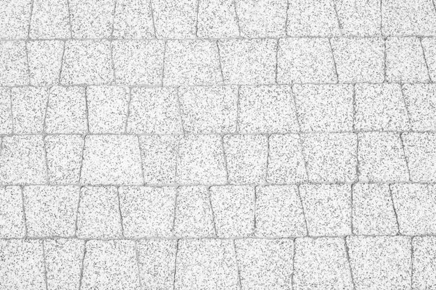 White paving slabs with marble inclusions.