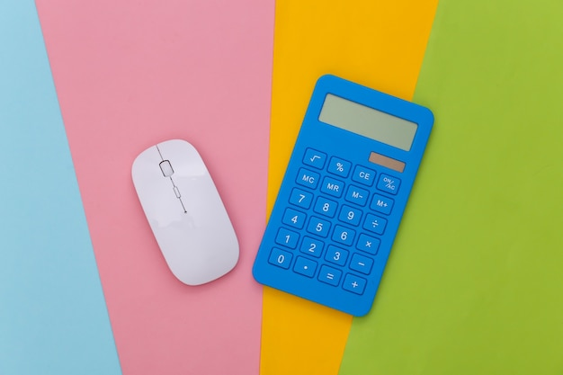 White pc mouse and blue calculator