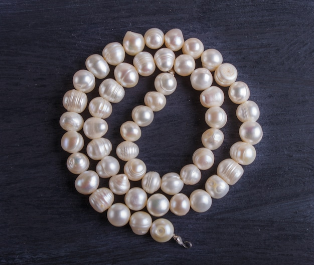 White pearl beads on a black background