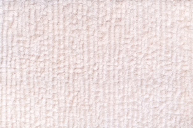 White pearl fluffy background of soft, fleecy cloth. texture of textile closeup.