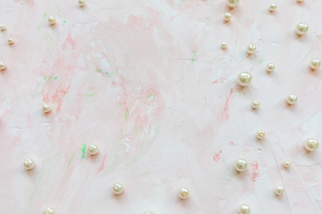 White pearls on pink. creative abstract background