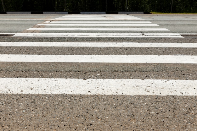 White pedestrian crossing across the road.