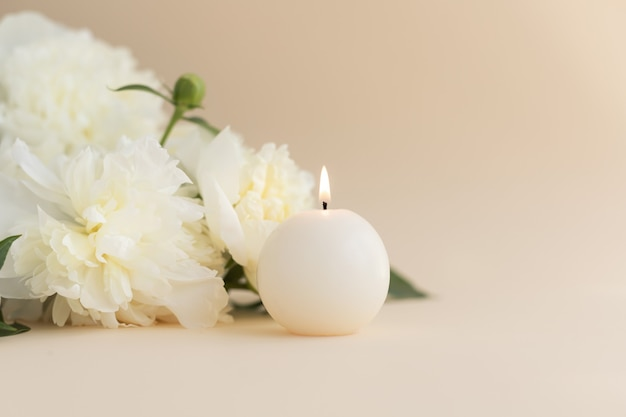 White peonies and aroma candles