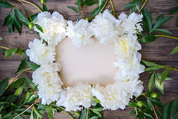 White peony frame on wooden frame