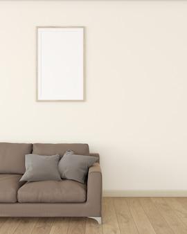 크림색 벽의 흰색 포토 프레임은 나무 바닥에 갈색 소파로 장식되어 있습니다.