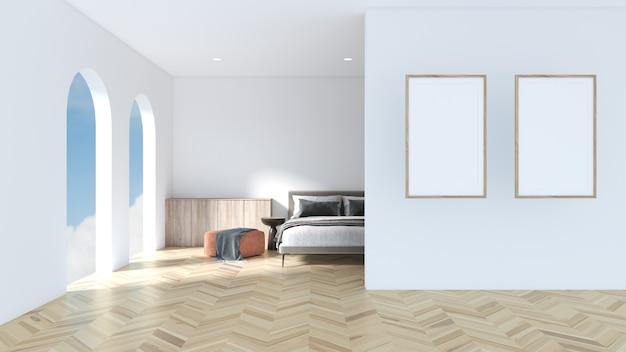 흰색 벽에 흰색 포토 프레임이 있는 방은 침대, 좌석, 쪽모이 세공 마루 바닥 쇼케이스로 꾸며져 있습니다.