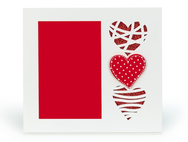 White photo frame with red hearts