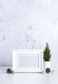 White photo frame with trees, pine cones and christmas balls