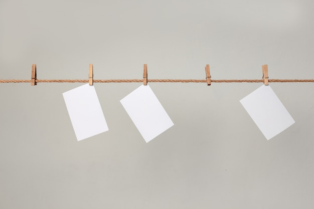 White photo paper. hanging on a clothesline with clothespins.