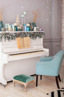 White piano decorated for christmas