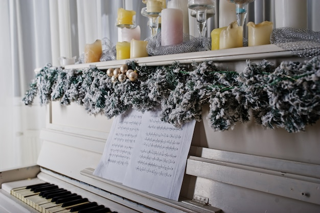 White piano with candles