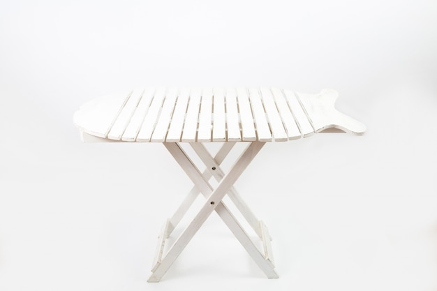 White picnic table isolated on a white wall