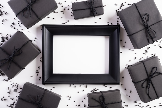 White picture frame with black gift box