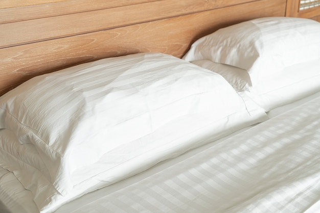 White pillow on bed decoration interior of hotel bedroom