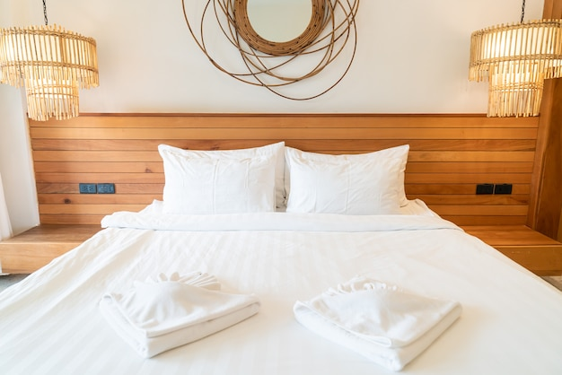 White pillow decoration on bed in bedroom interior