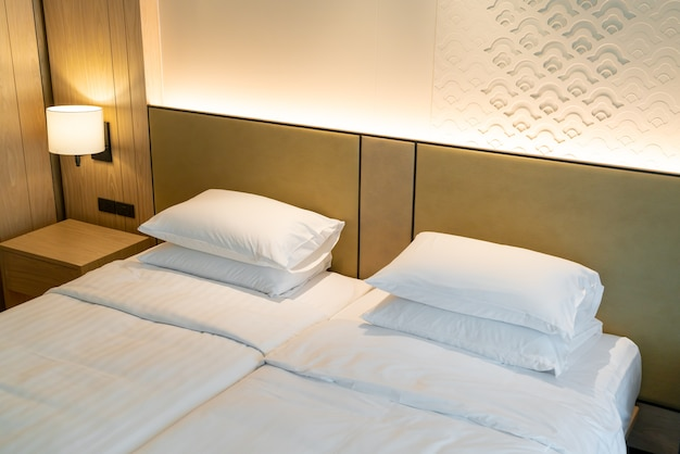 White pillow decoration on bed in hotel resort bedroom