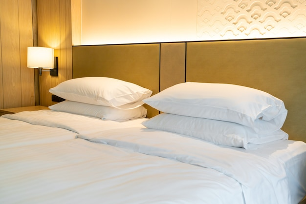 White pillow decoration on bed