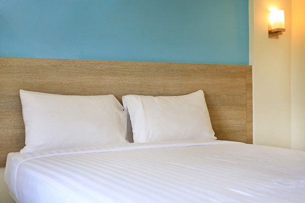 White pillows on a bed in hotel.