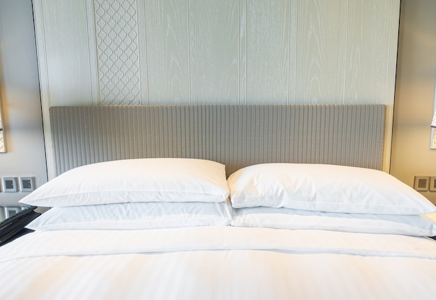 White pillows decoration on bed in bedroom interior Premium Photo