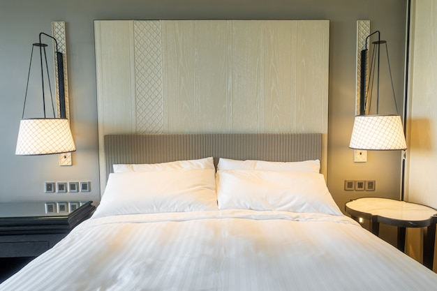 White pillows decoration on bed in bedroom