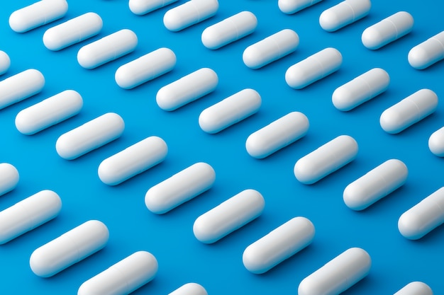 White pills of many painkillers with a pattern on a medical blue surface. capsule pills for alleviating illness or fever. 3d rendering.