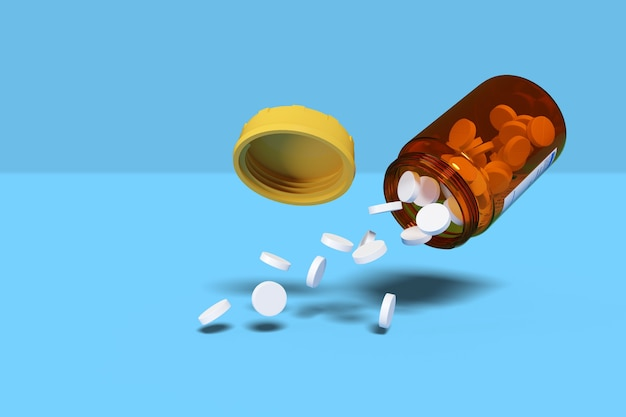 White pills spilling out of pill bottle isolated on blue background.