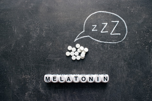 White pills in z shape and text. sleeping pills, hypnotic drugs