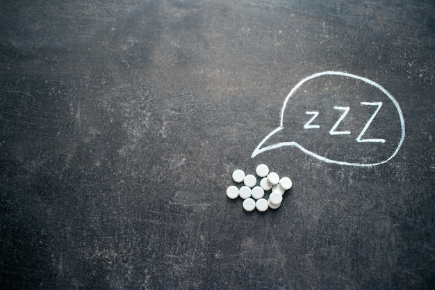 White pills in z shape
