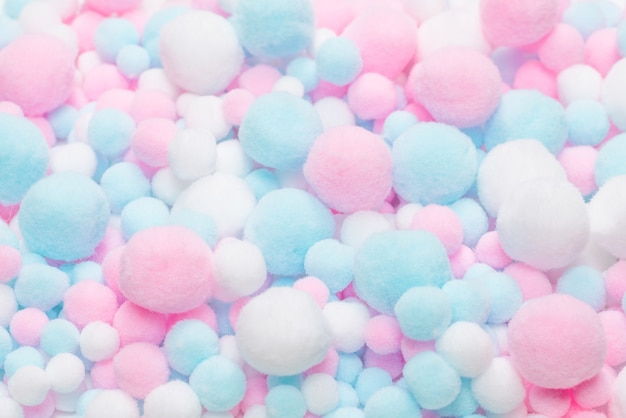 White, pink and blue soft pompons background