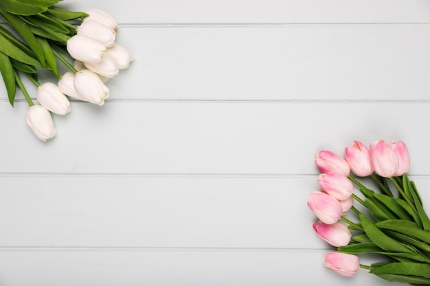 White and pink tulips bouquets on table