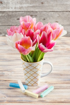 White and pink tulips and pastel colored chalks
