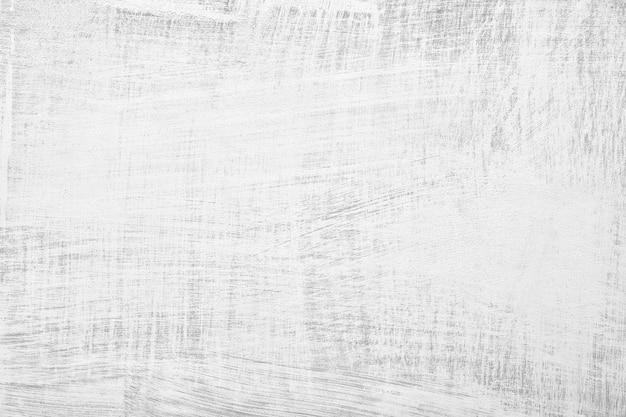 Белая штукатурка на стене старинный фон или текстуру