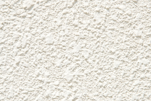 White plastered wall with a rough surface