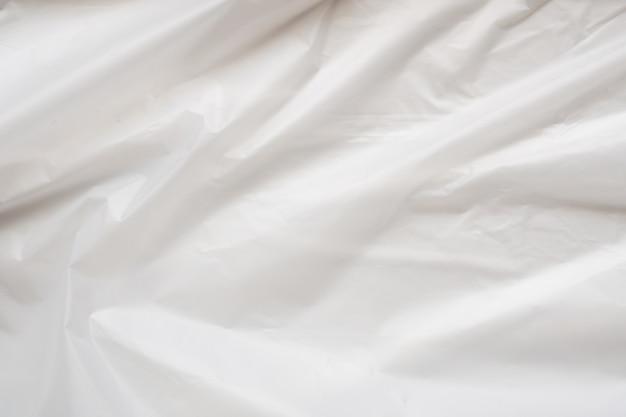 白いビニール袋の背景のテクスチャをクローズアップ