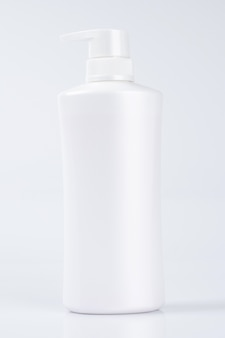 White plastic bottle container mock up, packaging product template isolated on white wall