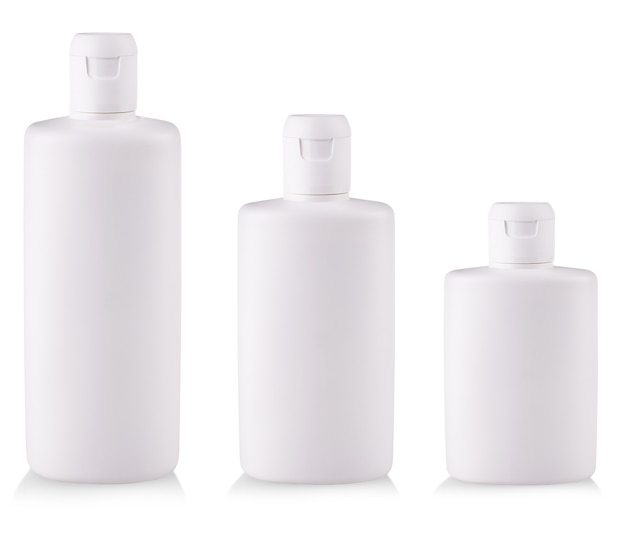 The white plastic bottles with soap or shampoo without label reflected on white background