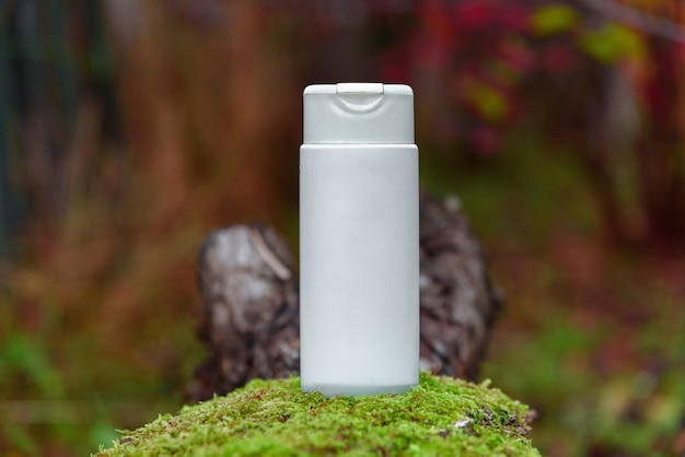 White plastic container on grass