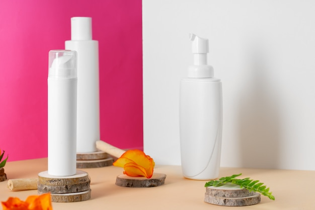 White plastic cosmetic containers with copy space