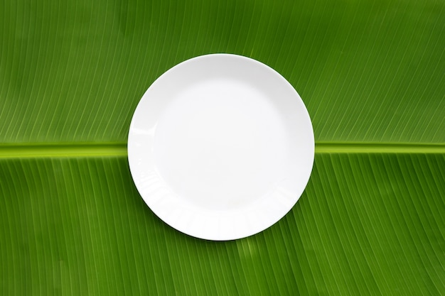 White plate on banana leaf