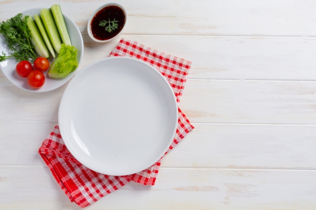 White plate ceramic on wihte wooden surface