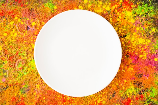 White plate on colourful table