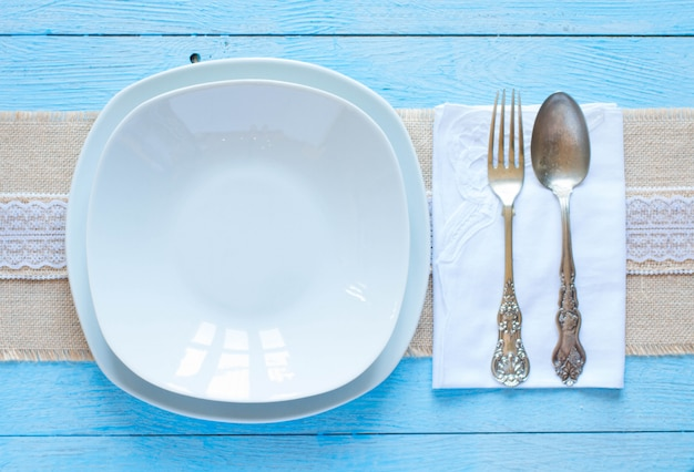 White plate and forkand spoon