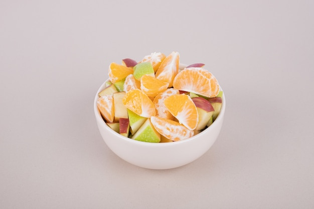 White plate of fresh slices of fruits